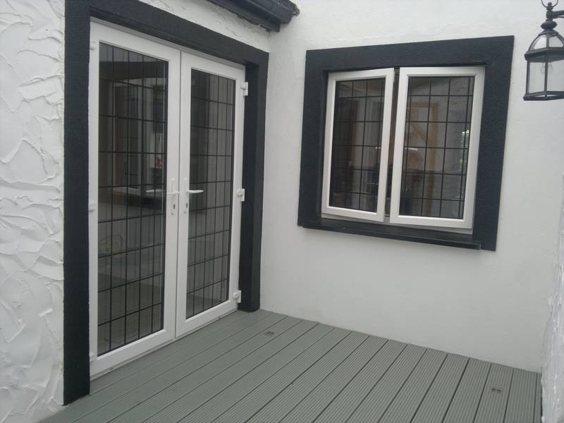 https://www.archerswindows.ie/wp-content/uploads/2019/06/White-French-Doors-with-Lead-Design.jpg